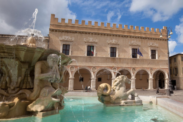 Fountain and Renaissance palace in Pesaro, Marches, Italy.