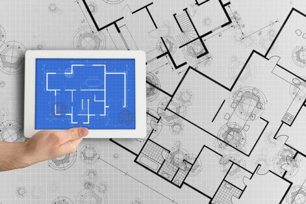 Digital tablet displaying blueprint --- Image by © Wavebreak Media Ltd./Corbis