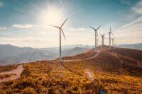 Wind turbines on beautiful sunny summer autumn mountain landsape. Curvy road through mountain Eolic park. Green ecological power energy generation. Wind farm eco field; Shutterstock ID 1223052007; Purchase Order: Varie